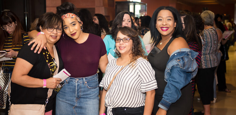 group of smiling women at girls night out annual event
