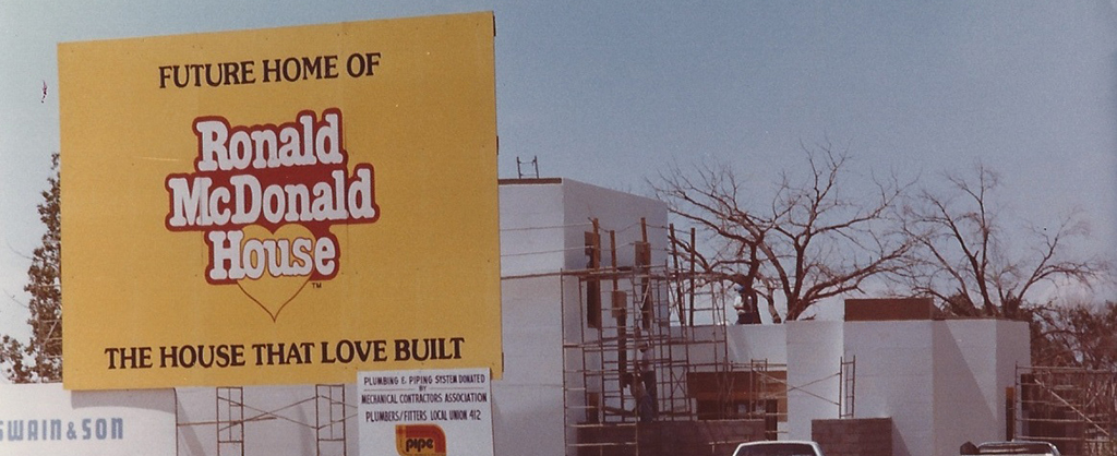 vintage picture of sign telling of future ronald McDonald's house under construction