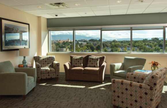 RMHC family room with nice comfy couches and chairs for family members to relax in