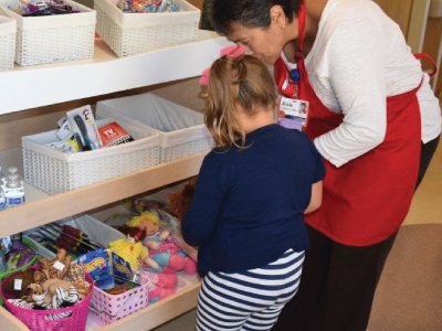 RMHC team member helping a child with Katie's Kart