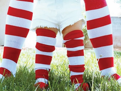 two pairs of red and white striped socks on a mother and child