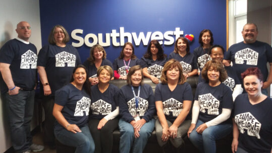 Group wearing matching event t-shirts and smiling