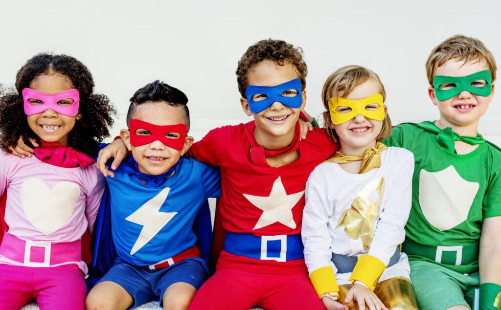 kids dressed in superhero costumes
