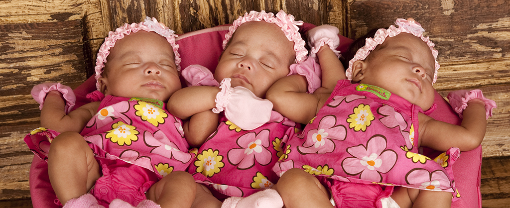 newborn triplets dressed identically sleeping soundly